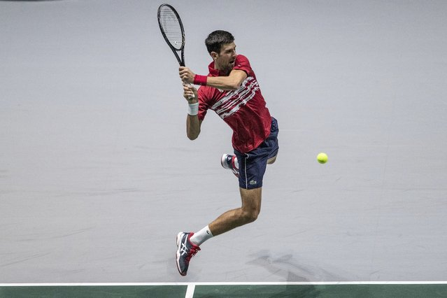 Serbia's Novak Djokovic returns the ball to Russia's Karen Khachanov during their Davis Cup tennis match in Madrid, Spain, Friday, November 22, 2019. (Photo by Bernat Armangue/AP Photo)