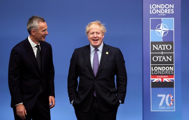 NATO Secretary General Jens Stoltenberg and Britain's Prime Minister Boris Johnson attend a welcoming ceremony at the NATO leaders summit in Watford, Britain on December 4, 2019. (Photo by Yves Herman/Reuters)