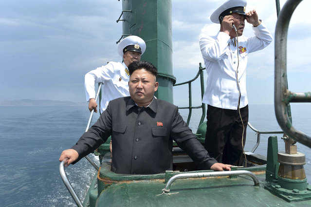 North Korean leader Kim Jong Un (front) stands on the conning tower of a submarine during his inspection of the Korean People's Army (KPA) Naval Unit 167 in this undated photo released by North Korea's Korean Central News Agency (KCNA) in Pyongyang June 16, 2014. (Photo by Reuters/KCNA)