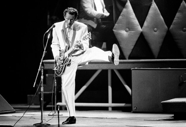 In this October 17, 1986 file photo, Chuck Berry performs during a concert celebration for his 60th birthday at the Fox Theatre in St. Louis, Mo. On Saturday, March 18, 2017, police in Missouri said Berry has died at the age of 90. (Photo by James A. Finley/AP Photo)