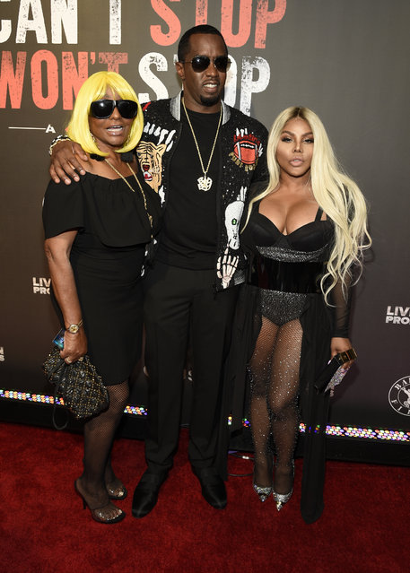 "Janice Combs, from left, Sean ""Diddy"" Combs and Lil' Kim arrive at the Los Angeles premiere of ""Can't Stop, Won't Stop: A Bad Boy Story"" at the Writers Guild Theater on Wednesday, June 21, 2017, in Beverly Hills, Calif. (Photo by Chris Pizzello/Invision/AP Photo)"