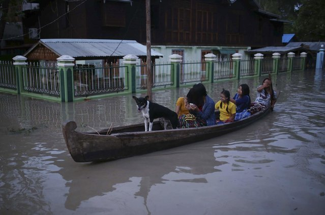 In this August 3, 2015, photo, residents make their way through floodwaters in Minbu, Magway division, in Myanmar. (Photo by Hkun Lat/AP Photo)