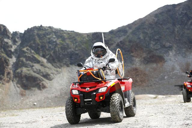 Inigo Munoz Elorza of Spain rides a quad bike during a simulated Mars mission on Tyrolean glaciers in Kaunertal August 7, 2015. (Photo by Dominic Ebenbichler/Reuters)