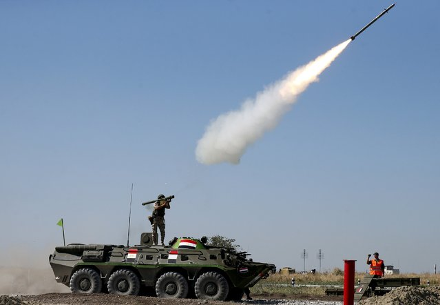 An Egyptian serviceman fires an anti-aircraft missile with a Russian-made Igla ground-to-air launcher as he stands on top of an armoured personnel carrier (APC) during the Air defense battle masters competition as part of the International Army Games 2015 in the port town of Yeysk, Russia, August 9, 2015. (Photo by Maxim Zmeyev/Reuters)