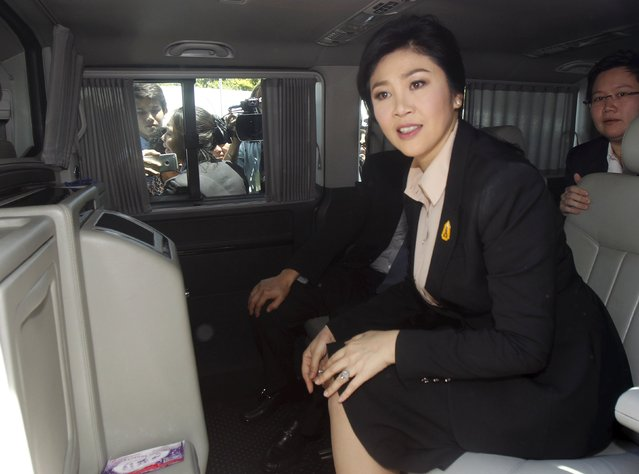 Ousted former Thai Prime Minister Yingluck Shinawatra sits in a van as she leaves the Supreme court in Bangkok, Thailand, May 19, 2015. (Photo by Chaiwat Subprasom/Reuters)