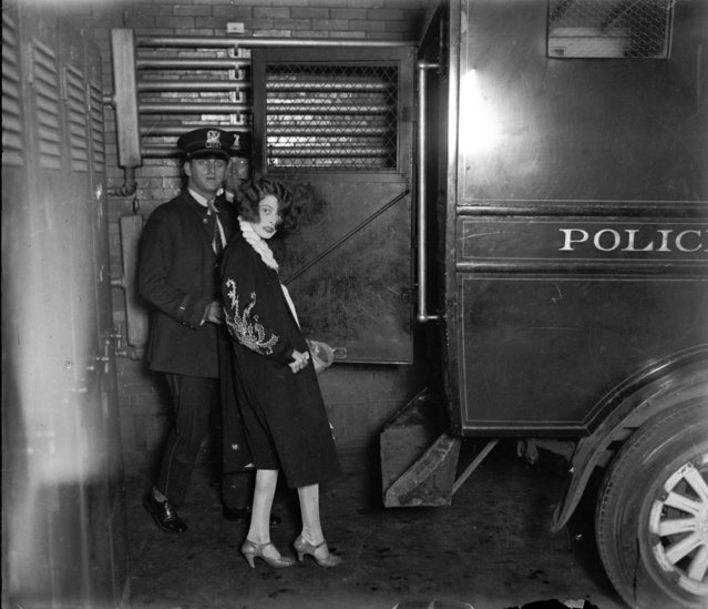 "Gertrude ""Billie"" Murphy, 22, is brought in for questioning in the murder case of Michael Stopec, who was shot and killed in an apartment hotel, circa July 1927.  Murphy had been friends of the married Stopec and his suspected killer Henry Guardino, 31. (Photo by Chicago Herald & Examiner Historical Photo)"