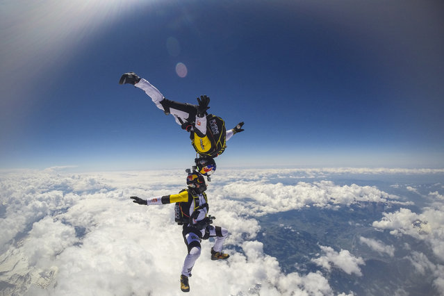 Fred Fugen and Vincent Reffet seen jumping at 33,000 feet (10 km) above the Mont Blanc, French Alps on May 31, 2014. Fearless skydivers jump from an altitude of 10,000 meters above the largest mountain in Europe. Frederic Fugen, 34, and Vincent Reffet, 29, leapt from a plane in the freezing skies above Mont-Blanc in the French Alps. (Photo by Dominique Daher/Barcroft Media)