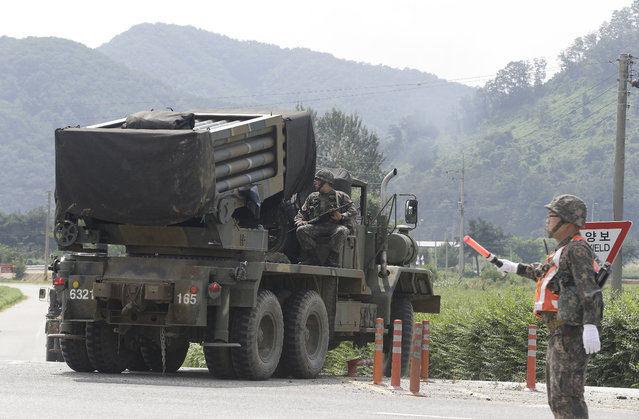 South Korean army's armored vehicle moves in Yeoncheon, south of the demilitarized zone that divides the two Koreas, South Korea, Saturday, August 22, 2015. The two Koreas prepared for a possible military clash Saturday as the North's deadline loomed for Seoul to dismantle loudspeakers broadcasting anti-North Korean propaganda across their border. (Photo by Ahn Young-joon/AP Photo)