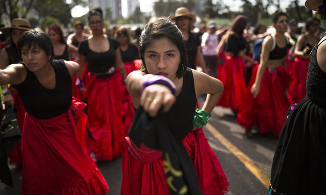 "Women perform the Chilean protest song about rape culture, ""A rapist in your path"", during a protest march marking International Women's Day, in Lima, Peru. Saturday, March 7, 2020. March 8th has been sponsored by the United Nations since 1975 as International Women's Day, celebrating women's achievements and aiming to further their rights. Marches and protests are held across the globe with calls for a more gender-balanced world to mark the day. (Photo by Rodrigo Abd/AP Photo)"