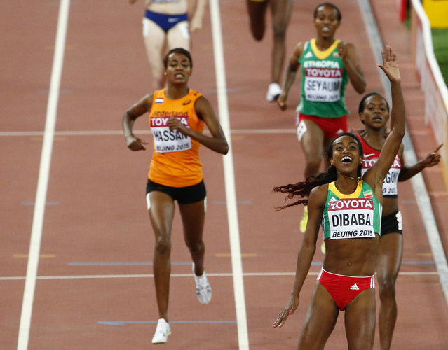 Genzebe Dibaba of Ethiopia gestures as she crosses the finish line first to win the women's 1500 metres final at the 15th IAAF World Championships at the National Stadium in Beijing, China August 25, 2015. (Photo by David Gray/Reuters)