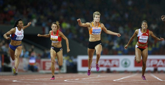 Dafne Schippers of the Netherlands (2nd R) crosses the finish line to win the women's 100 metres final during the European Athletics Championships at the Letzigrund Stadium in Zurich August 13, 2014. (Photo by Arnd Wiegmann/Reuters)