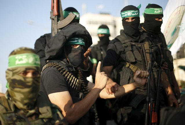 Palestinian Hamas militants take part in an anti-Israel military parade in Gaza City August 26, 2015. (Photo by Suhaib Salem/Reuters)