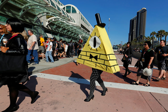 An attendee dressed as Bill Cipher arrives for opening day of the annual Comic-Con International in San Diego, California, United States July 21, 2016. (Photo by Mike Blake/Reuters)