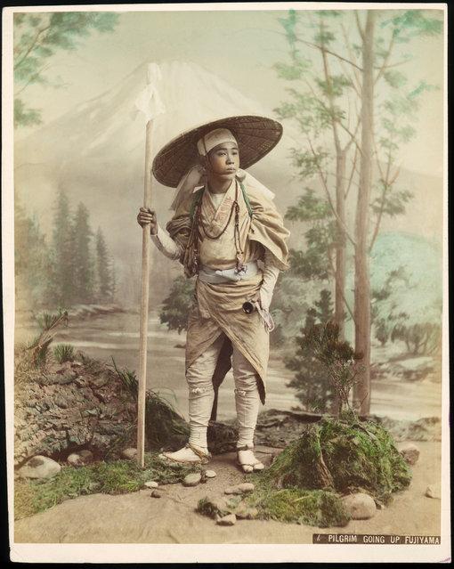 A pilgrim on his way to Mount Fuji (Fujiyama) on the Japanese island of Honshu, 1880. (Photo by Kusakabe Kimbei)
