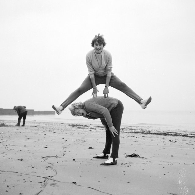 Northern Irish athlete Mary Peters on the beach with British high-jumper Dorothy Ada Shirley. 20th October 1962. (Photo by Ted West)