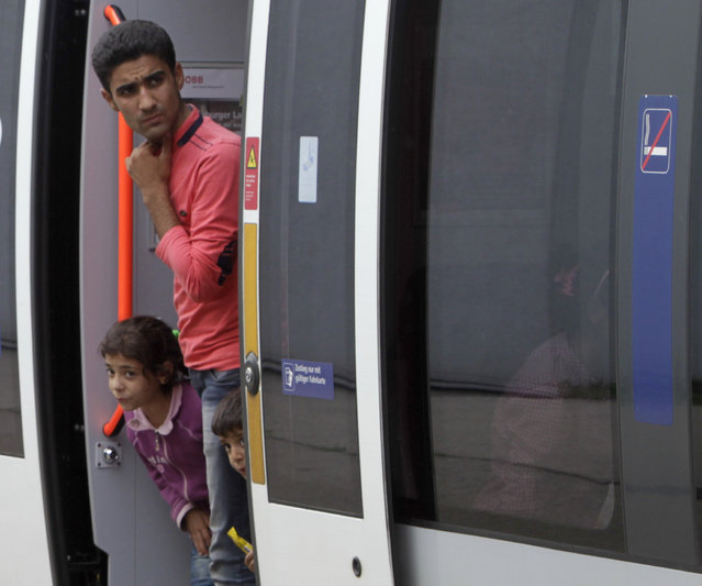 Migrants look out from a train at the railway station in Nickelsdorf, Austria September 5, 2015. (Photo by Srdjan Zivulovic/Reuters)