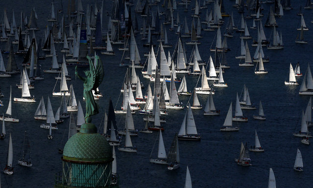 Sailing boats gather at the start of the Barcolana regatta in front of Trieste harbour, Italy October 8, 2017. (Photo by Stefano Rellandini/Reuters)