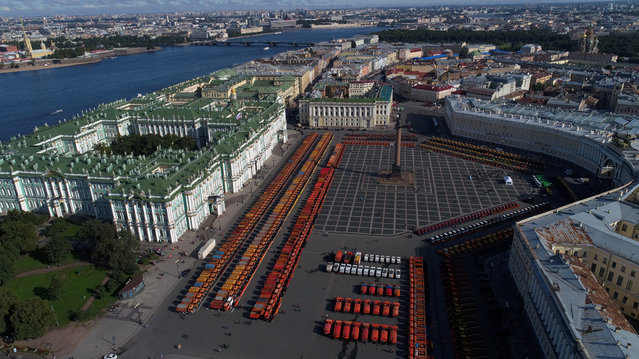 Snow ploughs and gritters on display in Palace Square ahead of the upcoming winter in St Petersburg, Russia on September 21, 2017. (Photo by Peter Kovalev/TASS/Getty images)