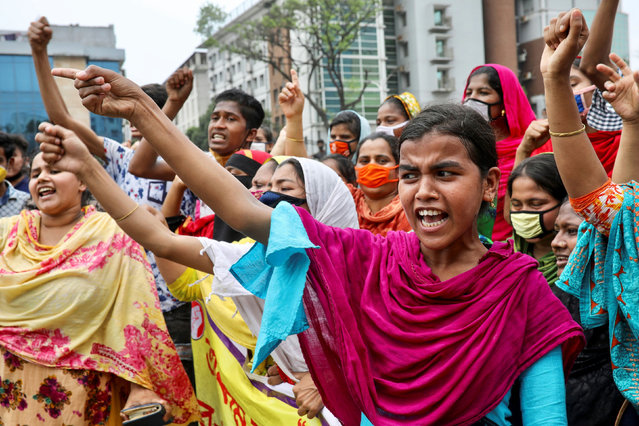 Garments workers shout slogans as they block a road demanding their due wages during the lockdown amid concerns over the coronavirus disease (COVID-19) outbreak in Dhaka, Bangladesh, April 15, 2020. (Photo by Mohammad Ponir Hossain/Reuters)