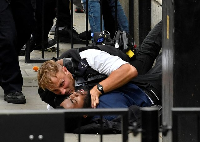 """A protester and a police officer clash near Downing Street during a """"Black Lives Matter"""" protest following the death of George Floyd who died in police custody in Minneapolis, London, Britain, June 3, 2020. (Photo by Toby Melville/Reuters)"""