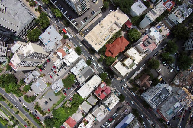 This September 23, 2014 photo, shows an aerial view of the Santurce neighborhood in San Juan, Puerto Rico. The neighborhood is bounded on the north and east by the upscale Atlantic Coast districts of Condado, Ocean Park and Isla Verde, areas familiar to tourists visiting Puerto Rico. To the west lies the largely middle-class area of Miramar and the approach to picturesque Old San Juan, a colonial district of cobblestone streets and the seat of local government. (Photo by Ricardo Arduengo/AP Photo)