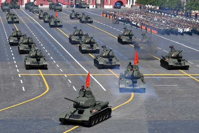 T-34 Soviet-era tanks drive during the Victory Day Parade in Red Square in Moscow, Russia, June 24, 2020. (Photo by Vladimir Pesnya/Host Photo Agency via Reuters)