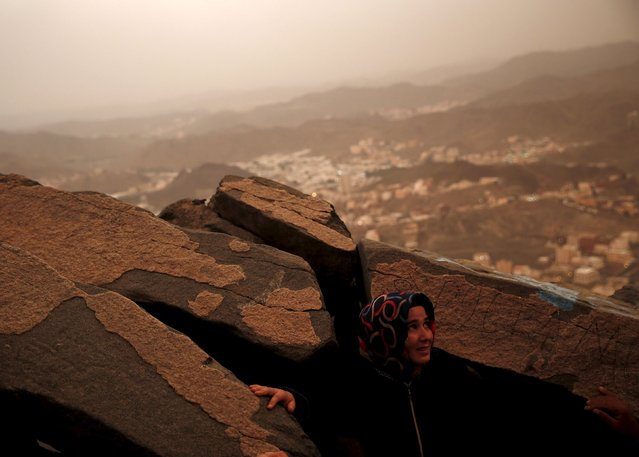 A Muslim pilgrim visits Hera cave, where Muslims believe Prophet Mohammad received the first words of the Koran through Gabriel, at the top of Mount Al-Noor during the annual haj pilgrimage in the holy city of Mecca, September 21, 2015. (Photo by Ahmad Masood/Reuters)