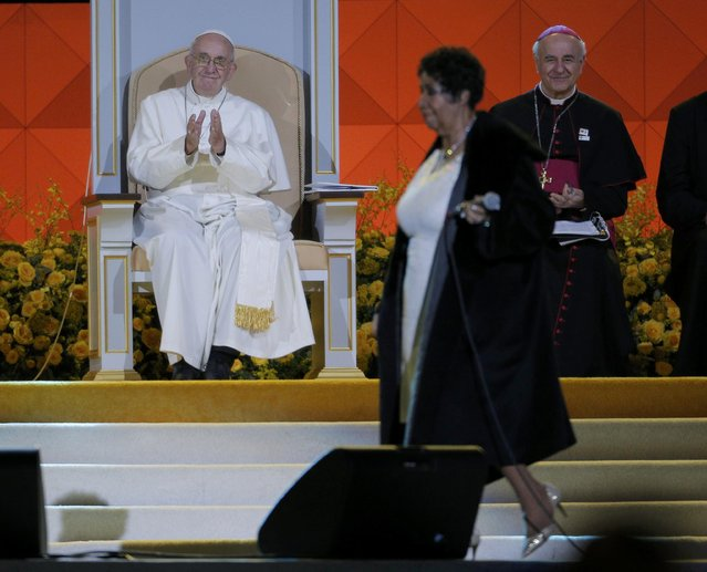 Pope Francis (L) applauds as singer Aretha Franklin performs as he attends the Festival of Families rally in Philadelphia, Pennsylvania September 26, 2015. (Photo by Brian Snyder/Reuters)