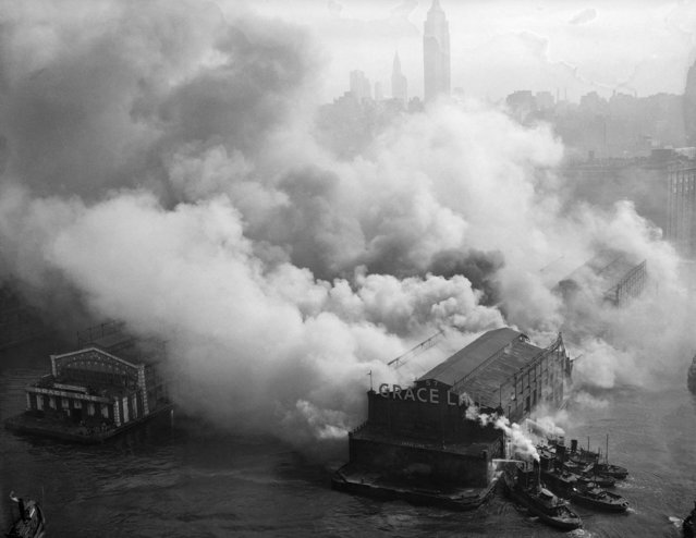 Smoke  from a massive fire pours out of Pier 57 on the Hudson River at 15th Street in New York, September 29, 1947. The blaze swept the structure for more than 16 hours causing most of the pier to collapse into the river. (Photo by AP Photo)