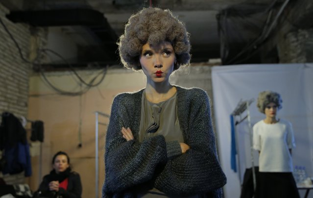 A model waits for a show backstage at Tbilisi Fashion Week, October 29, 2014. (Photo by David Mdzinarishvili/Reuters)