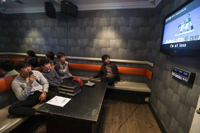 Sung Min See, 16, Jaewoong Lee, 17, Joon Kim, 16, and Jason Jung, 18, (L-R), who all emigrated from Seoul, South Korea, sing in a karaoke cafe in the Koreatown area of Los Angeles, California August 11, 2014. (Photo by Lucy Nicholson/Reuters)