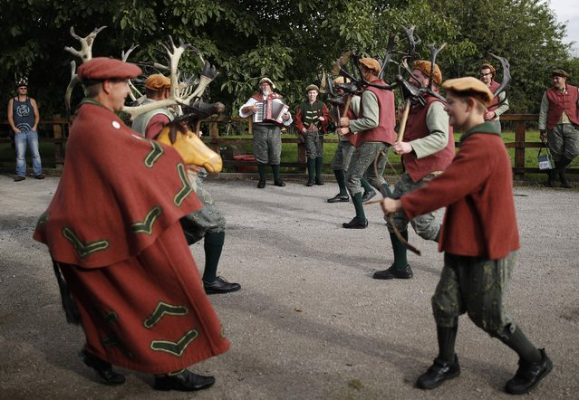 Musicians play as dancers perform the Abbots Bromley Horn Dance in Abbots Bromley, Britain, September 12, 2016. (Photo by Darren Staples/Reuters)