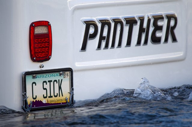 A custom license plate is shown on the back of a Panther WaterCar during the first Las Vegas Amphicar Swim-in at Lake Mead near Las Vegas, Nevada October 9, 2015. (Photo by Steve Marcus/Reuters)