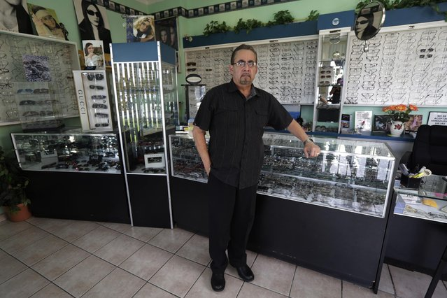 Former Cuban rafter Jose Ramon Velazquez, 60, poses in one of his optical stores in Miami, September 22, 2014. Velazquez said he was a radiologist when he decided to climb into a makeshift boat with 22 other migrants in 1994. (Photo by Rolando Pujol Rodriguez/Reuters)