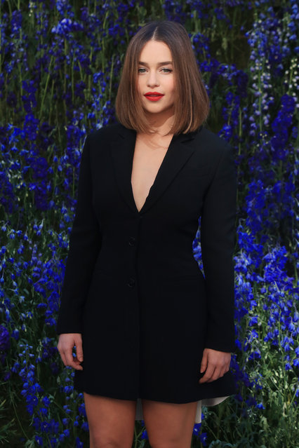 "In this October 2, 2015 file photo, British actress Emilia Clarke poses for photographers prior to the start of the Christian Dior's Spring-Summer 2016 ready-to-wear fashion collection in Paris, France. The 28-year-old Clarke, who plays menacing, white-haired Daenerys Targaryen, aka Khaleesi, aka Mother of Dragons on ""Game of Thrones"", is Esquire's Sexiest Woman Alive. The magazine made the announcement early Tuesday, October 13. (Photo by Thibault Camus/AP Photo)"