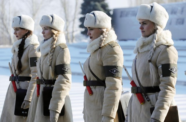 Girls dressed in Soviet WWII uniforms of traffic control officers as Russian President Vladiimir Putin lays a wreath in the Hall of Military Glory of the Mamayev Kurgan memorial complex commemorating the Battle of Stalingrad to mark the 75th anniversary of the victory in the battle in Volgograd, Russia on February 2, 2018. The battle between Nazi troops and the Soviet Army was a major pivotal moment in the Great Patriotic War and World War II. (Photo by Mikhail Metzel/TASS via Getty Images)