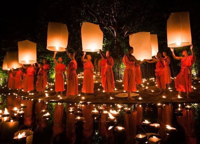 """Monks Releasing Lanterns During Loy Krathong in Chiang Mai, Thailand"". Photo by Daniel Nahabedian (Chiang Mai, Thailand). Photographed in Chiang Mai, Thailand, November 2012."