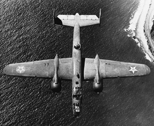 American Mitchell B-25 daylight medium bomber, now operating from Britain, in flight somewhere over the coast of Britain on January 25, 1943. (Photo by AP Photo)