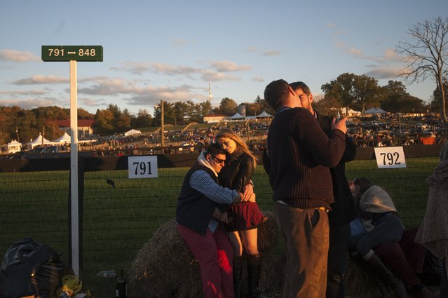 Two people embrace on the sidelines of the race course at the end of the Far Hills Race Day at Moorland Farms in Far Hills, New Jersey, October 17, 2015. (Photo by Stephanie Keith/Reuters)