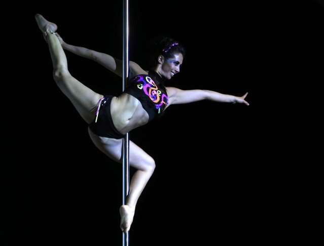 Ximena Rivero of Peru competes in the South American Pole Dance Championship in Buenos Aires November 24, 2014. Participants from throughout South America will be vying for the top spots in the two-day competition, with the winners qualifying for the 2015 World Pole Dance Championship in Hong Kong. (Photo by Enrique Marcarian/Reuters)
