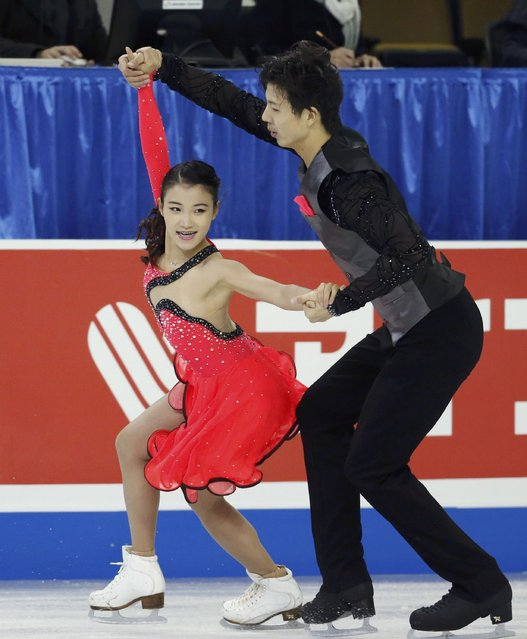 Wang Shiyue and Liu Xinyu of China perform during the ice dance short program at the Skate America figure skating competition in Milwaukee, Wisconsin October 23, 2015. (Photo by Lucy Nicholson/Reuters)