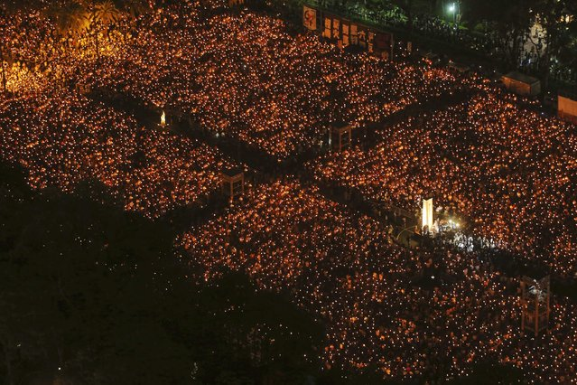 Tens of thousands of people participate in a candlelight vigil at Hong Kong's Victoria Park, to mark the 25th anniversary of the military crackdown of the pro-democracy movement at Beijing's Tiananmen Square in 1989, in this June 4, 2014 file photo. (Photo by Paul Yeung/Reuters)