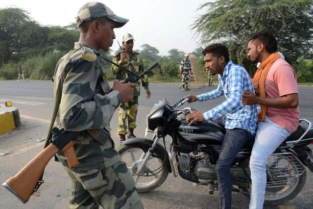 "Indian Border Security Force (BSF) personnel do a security check at the India-Pakistan Wagah Border, about 35 km from Amritsar on September 29, 2016, after the Punjab state government issued a warning to villagers to evacuate from a 10 km radius from the India-Pakistan border. Indian commandos carried out a series of lightning strikes September 29 along the de facto border with Pakistan in Kashmir, provoking furious charges of ""naked aggression"" from its nuclear-armed neighbour. (Photo by Narinder Nanu/AFP Photo)"