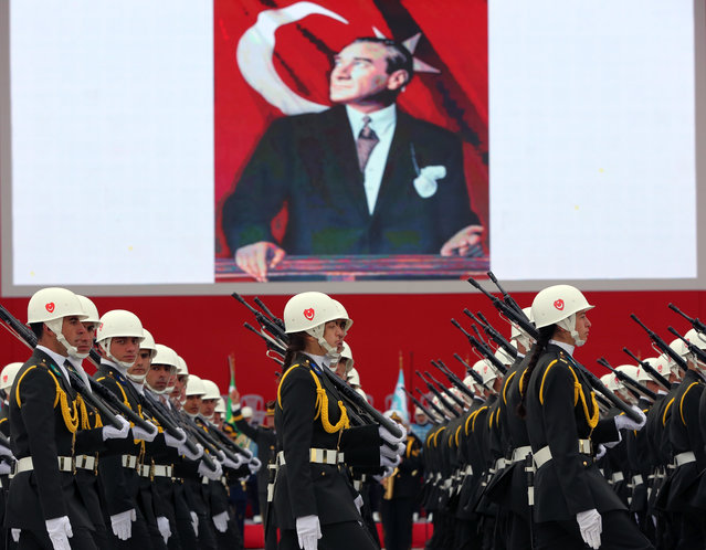Turkish War Academy students parade during celebrations on Republic Day in Ankara, Turkey, Thursday, October 29, 2015. An image of Turkey's founder Mustafa Kemal Ataturk is in the background. (Photo by Burhan Ozbilici/AP Photo)