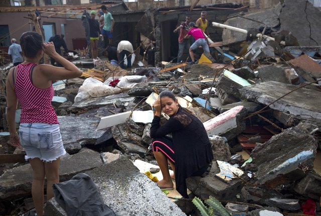 A woman cries amid the rubble of her home, destroyed by Hurricane Matthew in Baracoa, Cuba, Wednesday, October 5, 2016. The hurricane rolled across the sparsely populated tip of Cuba overnight, destroying dozens of homes in Cuba's easternmost city, Baracoa, leaving hundreds of others damaged. (Photo by Ramon Espinosa/AP Photo)