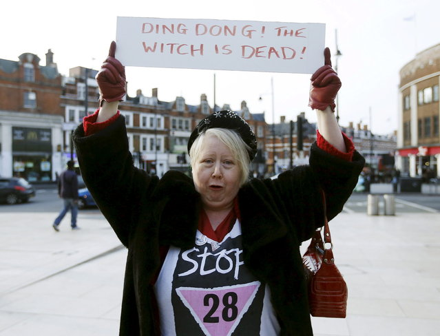 "A reveller holds a sign to celebrate the death of Britain's former prime minister Margaret Thatcher, at a party in Brixton, south London April 8, 2013. Margaret Thatcher, the ""Iron Lady"" who transformed Britain and inspired conservatives around the world by radically rolling back the state during her 11 years in power, died on Monday following a stroke. She was 87. (Photo by Olivia Harris/Reuters)"