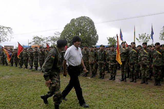 Bolivia's President Evo Morales (C) reviews troops in Chimore, east of La Paz, December 10, 2014. (Photo by David Mercado/Reuters)