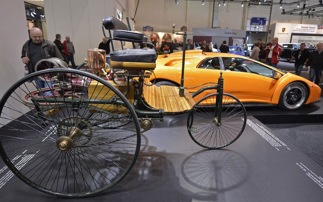 First car made by Carl Benz in 1886, with a maximum speed of 16 km/h, is displayed with Lamborghini Diablo, 1999, which reaches 338 km/h. Both vehicles are exposed to fair in Essen, Germany, on April 11, 2013. (Photo by Martin Meissner/AP Photo)