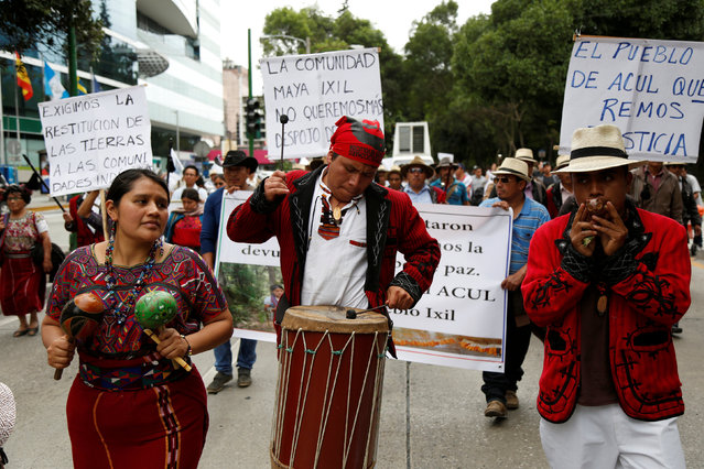 Indigenous people play music during a demonstration to demand equal rights as part of the Indigenous Resistance Day in Guatemala City, Guatemala, October 12, 2016. (Photo by Luis Echeverria/Reuters)