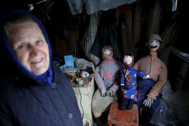 Local resident Babushka (Grandma) Shura shows her scarecrows in Sankin, Sverdlovsk region, Russia, October 16, 2015. (Photo by Maxim Zmeyev/Reuters)